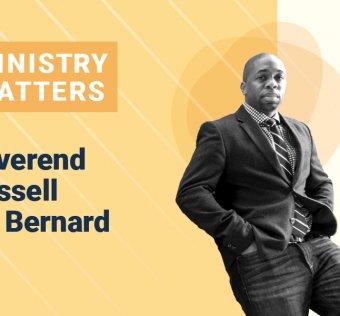 Reverend Russel St. Bernard Standing